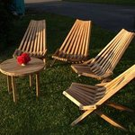 Relaxing cedar deck chairs on lawn.