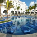 Lounges in pools and sun shades around pools