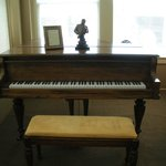 Piano in living area - Suite #2