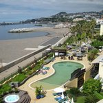 View from the 3rd floor terrace of hotel pool & gardens plus view towards marina