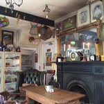 The main tea room filled with antiques and vintage items!