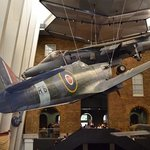 Spitfire & hurricane hang from ceiling.