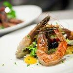 GAMBERONI  grilled shrimp, frisée salad, cured tomato, citrus segments, artichokes