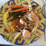 Yellowtail topped with shrimp and scallops. Yellow rice and veg.