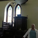 pulpit with a sounding board and our guide Mrs. LaBonne