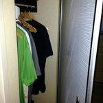 Closet hidden behind full length mirror. Safe at the bottom