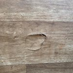 One of many rips in the flooring in our caravan