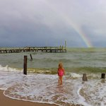 Rainbow after a storm and pier. Stunning View!