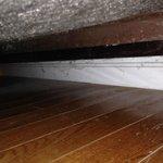 Spiderwebs under the bed