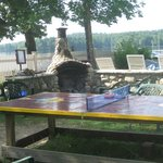 ping-pong table and outdoor fireplace