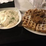 Classic waffle with chicken cutlet, grits, and eggs