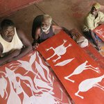 Gabriel Maralngurra, Don Namundja and Ezariah Kelly painting on-site