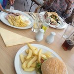 Clockwise : club sandwich (major), burger (nice), ham eggs (v. Nice) served on the balcony under