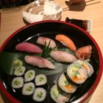 Sushi platter - mixed fish nigiri, cucumber rolls and California rolls