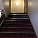 no handrail half way down stairs on one side none at all on other side