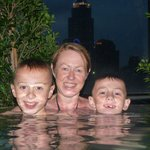 family in the rooftop pool