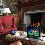 Watching the rugby by the fireplace