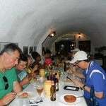 Our eclectic group dining on lunch they made in the tunnel.