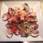 Fruitti de mare con pomadoro. Clams, muddled, shrimp with white wine sauce and pasta! Delicious.