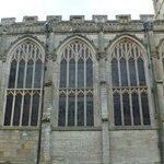 Details of fine gothic windows through which light flows.
