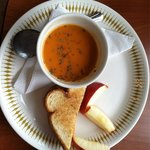 Kids grilled cheese with tomato basil soup. (Portion includes two slices if grilled cheese)