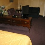 TV turns to be veiew from the large seating area or the comfortable bed