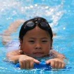 Daughter in the lap pool