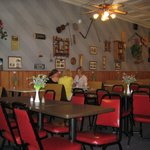 The inside of the restaurant. The walls are adorned with old pictures and collectables