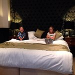 A happy couple settling down for an evenings TV in the Shakespeare Suite