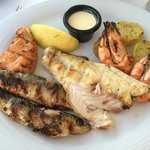 A platter of grilled fish and shellfish
