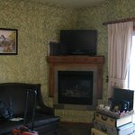 Lovely fireplace and flat screen tv