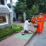 In front of hotel. You can request the food for offer the monk, this service is about 15$