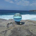 Coastal view through large globe