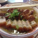 soup topped with crispy pork