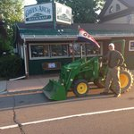 "Jason participating in ""drive your tractor to school day"""