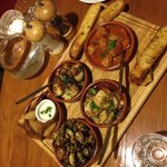 Tapas (Brusselsprouts bacon, prawn, friend corn dumpling, meatball, and scalpp) anddd garlic bre