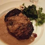 Kona dry-rubbed bone-in steak with shallot butter sauce and a side of sauteed spinach