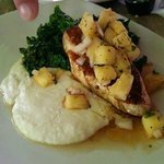 Blackened Wahoo with pineapple salsa, wilted garlic kale and coconut grits.