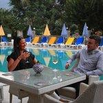 Enjoying drinks by the pool