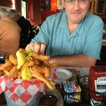 My husband with the shrimp basket appetizer