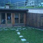 Veranda esterna con cucina a legna