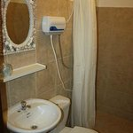 The beautiful bathrooms have all basic needs.