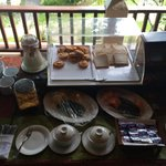 Western-style part of breakfast buffet. Jam containers infested with flies. July 2014