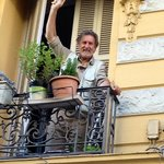 Steve waving from our balcony at Chez Josephine