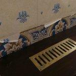 Hideous peeling wallpaper in corridors