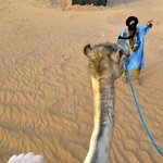 Riding the camel I named Camela with our tour guide in front