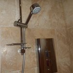 lovely tiled bathroom with fab power shower