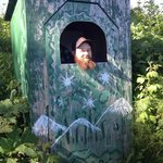joking around at our outhouse (no, he isn't really using it here!)