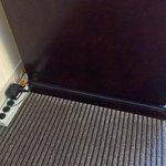 Powerstrip sticking out from behind TV