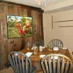 local artists' work hangs in the dining room